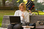 Woman working on laptop, concentrating