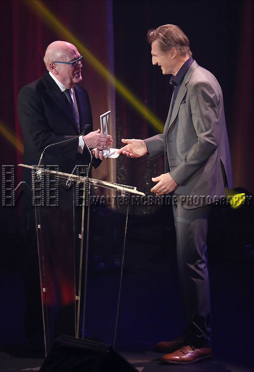 Thomas E. Tufts and Liam Neeson onstage during the Roundabout Theatre Company's  50th Anniversary Gala at The Waldorf-Astoria on February 29, 2016 in New York City.