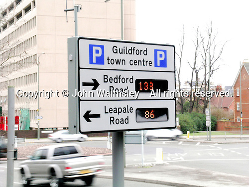 Automatic sign giving drivers information about available parking in a town centre.  It works by radio signal from a central base.