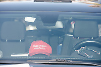 A MAGA hat and POW MIA flag are seen in a vehicle in the Straight Pride Parade in Boston, Massachusetts, on Sat., August 31, 2019. The parade was organized in reaction to LGBTQ Pride month activities by an organization called Super Happy Fun America.