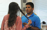 NWA Democrat-Gazette/FLIP PUTTHOFF<br /> Ryan Quintana and a Lingle Middle School student chat Friday Sept. 23 2016 during a science class. Quintana also teaches world history at Lingle.