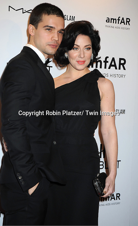 Lynn Collins and Steven Straight arrives at the amfAR New York Gala to kick off Fashion Week on February 8, 2012 at Cipriani Wall Street in New York City.