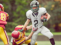 Peninsula wide receiver Jake Boley (2) blocks a tackle from O'Dea linebacker Sean Yanuss (10) at Memorial Stadium in Seattle, Washington, on Saturday, November 6, 2010. O'Dea won the game 21-7.