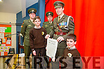 Gaelscoil Mhic Easmainn was Presented with the 1916 proclamation and Irish flag  on Tuesday by Irish defence forces Members Commandant Peadar o Cathain, Gunnadoir Daithi Breathnach, Ceannaire Marcus o Dulaing. Pictured are the Youngest and Oldest students Lucas o Croinin and Lucas o Ceallachain