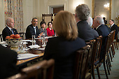 """United States President Barack Obama, second from left, speaks while meeting with members of the Democratic Governors Association in the State Dining Room with U.S. Vice President Joseph """"Joe"""" Biden, from left, Valerie Jarrett, senior advisor to Obama, and Cecilia Munoz, director of the White House Domestic Policy Council, in Washington, D.C., U.S., on Friday, Feb. 21, 2014. Obama will emphasize Democratic priorities in his next budget, dropping an offer to trim the growth of entitlement spending and proposing new tax limits for U.S.-based multi-national companies. <br /> Credit: Andrew Harrer / Pool via CNP"""