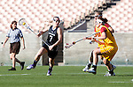 Los Angeles, CA 02/09/13 - Erin Fitzgerald  (Northwestern #7) and Ceilidh Meagher (USC #20) in action during the Northwestern vs USC NCAA Women Lacrosse game at the Los Angeles Colliseum.