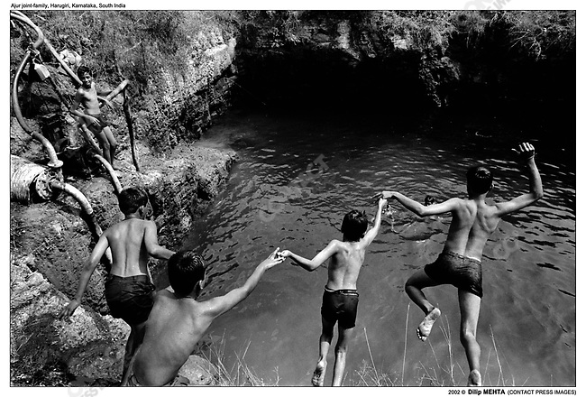 On the weekends, and sometimes on excessively warm summer weekdays, the youngsters - boys and girls alike swim and frolic in a large water filled pit. This pit is the main source for watering the fields surrounding the family residence.