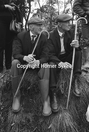 Appleby in Westmorland Horse fair Cumbria. 1981  Local farmers watch the gypsy horses being shown.