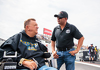 Aug 30, 2019; Clermont, IN, USA; NHRA top fuel driver Mike Salinas (right) talks with former driver Darrell Gwynn during qualifying for the US Nationals at Lucas Oil Raceway. Mandatory Credit: Mark J. Rebilas-USA TODAY Sports