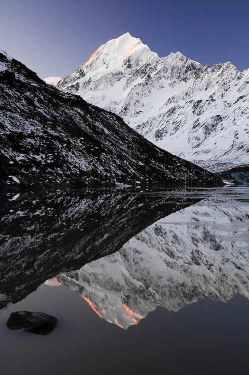 Mt Cook summit is reflected in the mirror calm waters of the Hooker Glacier terminal lake. New Zealand - stock photo, canvas, fine art print