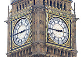 "London, GBR - August 7, 2005 -- Close-up of the Clock Tower of the Palace of Westminster, popularly known as ""Big Ben"".  The Clock is one of the largest in the world.  Its hour hand is 9 feet (2.7 m) long and the minute hand is 14 feet (4.3 m) long.  At the base of each clock face in gilt letters is the Latin inscription 'DOMINE SALVAM FAC REGINAM NOSTRAM VICTORIAM PRIMAM' which means 'Lord save our Queen Victoria I'. This view is from a ferry on the River Thames..Credit: Ron Sachs / CNP"
