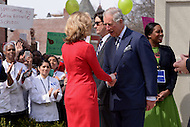 Washington, DC - March 19, 2015: His Royal Highness The Prince of Wales greets Allison Kokkoros in front of the Carlos Rosario Public Charter School in the District of Columbia March 19, 2015, during a four-day USA visit. Kokkoros serves as Executive Director of the school. (Photo by Don Baxter/Media Images International)