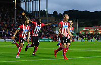 Lincoln City's Harry Anderson, third in from left, celebrates scoring the opening goal with team-mates, from left, Bruno Andrade, John Akinde and Harry Toffolo<br /> <br /> Photographer Chris Vaughan/CameraSport<br /> <br /> The Carabao Cup Second Round - Lincoln City v Everton - Wednesday 28th August 2019 - Sincil Bank - Lincoln<br />  <br /> World Copyright © 2019 CameraSport. All rights reserved. 43 Linden Ave. Countesthorpe. Leicester. England. LE8 5PG - Tel: +44 (0) 116 277 4147 - admin@camerasport.com - www.camerasport.com
