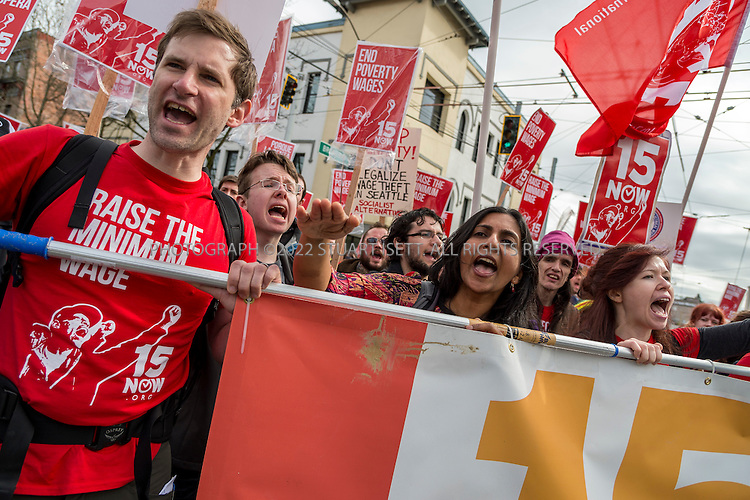 3/16/2014&mdash;Seattle, WA, USA<br /> <br /> <br /> Socialist Seattle city council member, Kshama Sawant (Center, hand raised) leads a march organized by a  group started to push for a raise in the minimum wage called &ldquo;$15 Now!&rdquo;. The march and rally were held to demand the city council raise the minimum wage to $15 per hour. Several hundred people marched from Judkins Park in the city&rsquo;s Central District  to Seattle Central Community College on Capitol Hill where a rally was held. Social city council member Kshama Sawant spoke at the rally.<br /> <br /> Photograph by Stuart Isett<br /> &copy;2014 Stuart Isett. All rights reserved.