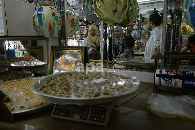 A Palestinian vendor displays sweets in his shop for the families of general secondary certificate students in Gaza city on July 22,2010. The Ministry of Education in Gaza Strip and the West Bank announced the results together. Photo by Ashraf Amra