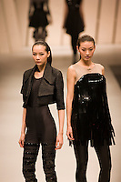 Young women model designer clothes in opening show of China Fashion Week at the Beijing Hotel, China