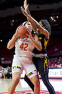 College Park, MD - DEC 6, 2016: Maryland Terrapins center Brionna Jones (42) goes up strong to the basket against Towson Tigers center Daijha Thomas (33) during game between Towson and Maryland at XFINITY Center in College Park, MD. The Terps defeated the Tigers 97-63. (Photo by Phil Peters/Media Images International)
