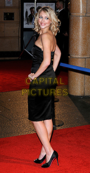 ALI BASTIAN .Attending the UK Premiere of 'Me and Orson Welles' at the Vue West End, Leicester Square, London, UK,.November 18th 2009.full length black dress  strapless hands on hips peep toe shoes heels looking over shoulder back rear behind .CAP/CAN.©Can Nguyen/Capital Pictures.