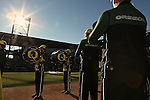 010213--The Oregon Ducks marching band plays before the Oregon Ducks fans during the Ducks pep rally at Salt River Fields in  Scottsdale, Arizona. .Photo by Jaime Valdez