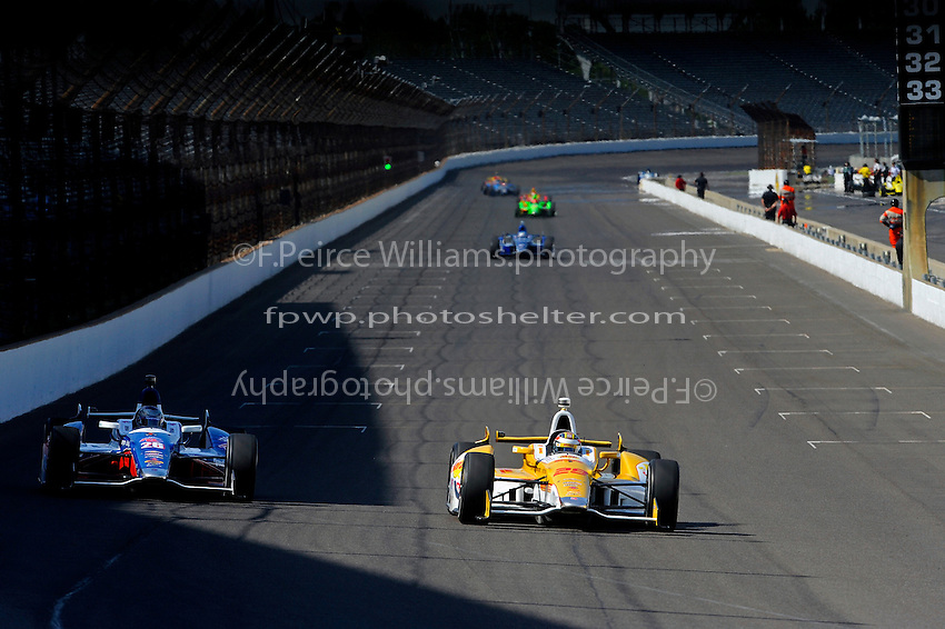 Ryan Hunter-Reay (#28) leads teammate Marco Andretti (#26) into turn one.