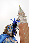 VENICE - FEBRUARY 27: An unidentified person in costume in St. Mark's Square during the Carnival of Venice on February 27, 2011.  The annual carnival was held in 2011 from February 26th to March 8th.