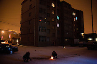 People light fireworks in an apartment building courtyard in Pingliang, Gansu Province, China.
