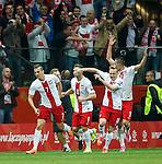 Arkadiusz Milik (L) scores for Poland and celebrates