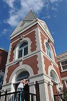 NWA Democrat-Gazette/FLIP PUTTHOFF<br /> CAULK AND PAINT<br /> Randy James applies caulk while working Tuesday Sept. 15 2015 at First United Methodist Church in downtown Rogers. James was doing caulk and painting work at the historic church, located at 307 W. Elm St.