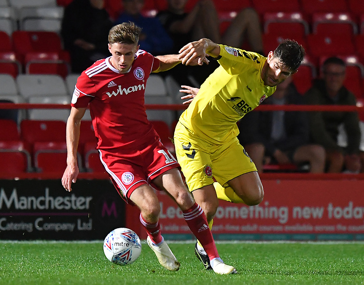 Fleetwood Town's Ched Evans battles with Accrington Stanley's Joe Pritchard<br /> <br /> Photographer Dave Howarth/CameraSport<br /> <br /> EFL Leasing.com Trophy - Northern Section - Group B - Tuesday 3rd September 2019 - Accrington Stanley v Fleetwood Town - Crown Ground - Accrington<br />  <br /> World Copyright © 2019 CameraSport. All rights reserved. 43 Linden Ave. Countesthorpe. Leicester. England. LE8 5PG - Tel: +44 (0) 116 277 4147 - admin@camerasport.com - www.camerasport.com