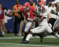 Atlanta, Georgia - December 1, 2018: Mercedes-Benz Stadium, the number 1 ranked University of Alabama Crimson Tide and the number 4 ranked Georgia Bulldogs for the SEC Championship.  Final score UGA 28, Alabama 35.