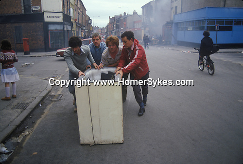 Toxteth Liverpool Lancashire 1981. Looting  after the riots the following day.