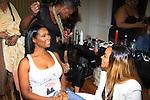 Jennifer Williams (walking in fashion show) chats with Tami Roman both Basketball Wives at Samantha Black Fashion Show - NYC Fashion Week - September 7, 2013 - New York City, NY (Photo by Sue Coflin/Max Photos)