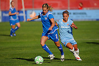 Heather Mitts (2) of the Boston Breakers is chased by Kacey White (20) of Sky Blue FC. Sky Blue FC defeated the Boston Breakers 2-1 during a Women's Professional Soccer match at Yurcak Field in Piscataway, NJ, on May 31, 2009.