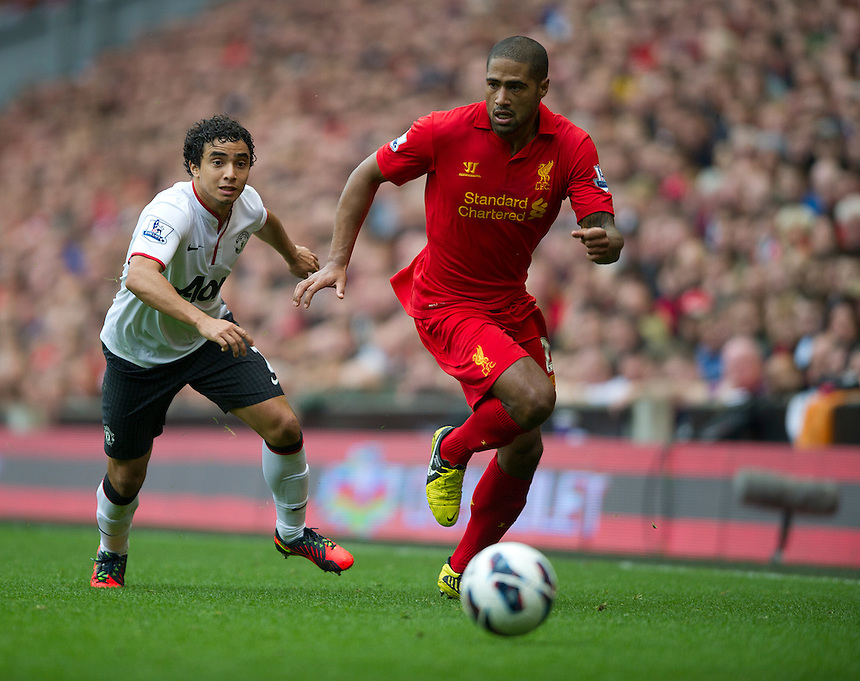 Liverpool's Glen Johnson gets away from Manchester United's Rafael ..Football - Barclays Premiership - Liverpool v Manchester United - Sunday 23rd September 2012 - Anfield - Liverpool..