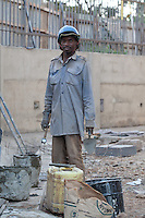 A mason at work in Nairobi, Kenya. He is part of a construction crew working to finish an expansion of The Junction shopping center in Nairobi, Kenya.
