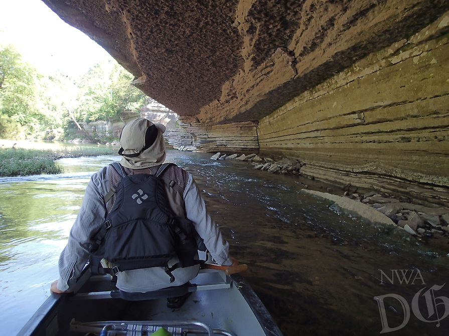 NWA Democrat-Gazette/FLIP PUTTHOFF<br /> A bluff overhang provides habitat for cliff swallows Thursday June 11 2015 and cool shade for paddlers.