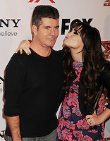 LOS ANGELES, CA - DECEMBER 06: Simon Cowell and Demi Lovato  arrive at the 'The X Factor' Viewing Party Sponsored By Sony X Headphones at Mixology101 & Planet Dailies on December 6, 2012 in Los Angeles, California.PAP1212JP346.PAP1212JP346.PAP1212JP346.
