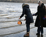 Detail photo as, individual participants scatter a liquid from a kettle on the water during a Native American Water Blessing Ceremony held for the Hudson River, sponsored by the Association of Native American of the Hudson Valley, at Kingston Point Beach in Kingston, NY, on Saturday, March 4, 2017. Photo by Jim Peppler; Copyright Jim Peppler 2017