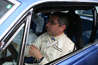 Goodwood Revival, 2007.Rowan Atkinson, (aka. Mister Bean) is a fanatic vintage car driver. The Goodwood revival is one of the largest historic car races events in the world; 3 days of racing at the highest level with some of the best pilots past and present driving historically important cars to the limit...and sometimes beyond! 110 000 spectators and participants gather in period costumes for a unique event.