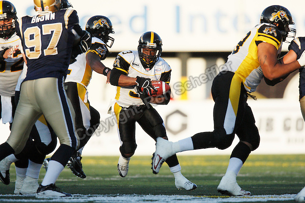 Jun 22, 2007; Hamilton, ON, CAN; Hamilton Tiger-Cats running back (3) Corey Holmes during the game against the Winnipeg Blue Bombers in CFL preseason action at Ivor Wynne Stadium. The Tiger-Cats defeated the Blue Bombers 24-20. Mandatory Credit: Ron Scheffler, Special to the Spectator. For exclusive EDITORIAL use by the Hamilton Spectator only.