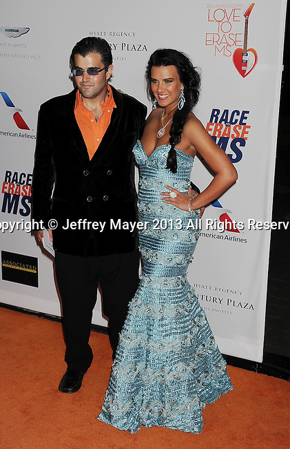 CENTURY CITY, CA- MAY 03:  Jason Davis and guest arrive arrives at the 20th Annual Race To Erase MS Gala 'Love To Erase MS' at the Hyatt Regency Century Plaza on May 3, 2013 in Century City, California.