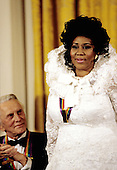 Kirk Douglas, left, and Aretha Franklin, right, two of the recipients of the 1994 Kennedy Center Honors, appears in the East Room of the White House in Washington, DC at a reception hosted by United States President Bill Clinton and first lady Hillary Rodham Clinton on December 2, 1994.<br /> Credit: Jeffrey Markowitz / Pool via CNP