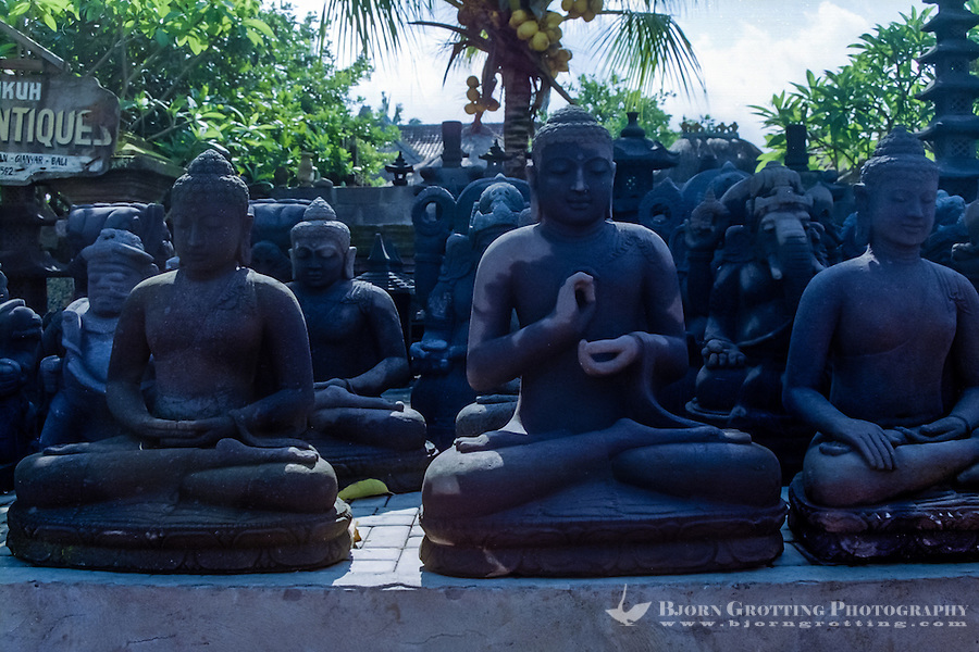 Bali, Gianyar, Batubulan. Stonecarvings, Buddha figures. Batubulan is a Balinese center for stonecarving.