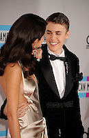 LOS ANGELES, CA - NOVEMBER 20: Selena Gomez and Justin Bieber arrive at the 2011 American Music Awards held at Nokia Theatre L.A. LIVE on November 20, 2011 in Los Angeles, California.