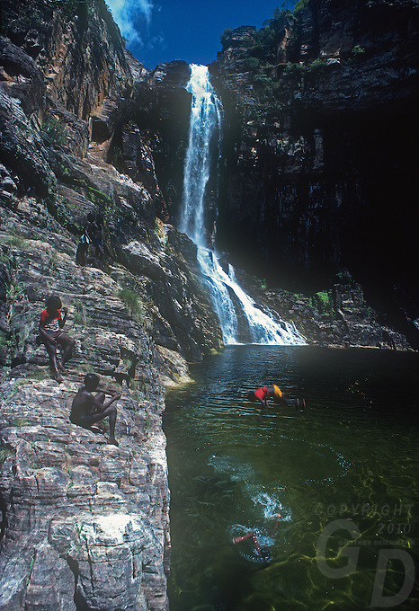 Tribal Aboriginal Children playing at a Waterfall in Arnhem Land,Northern Territory, Australia