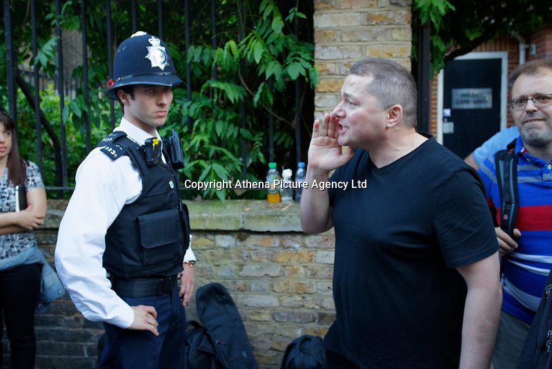 Pictured: A Greek protester (R) oustside the Hellenic Centre in London, UK. Monday 25 June 2018<br /> Re: Greek Prime Minister Alexis Tsipras is on a three day visit to London, UK.