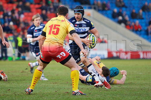 07.02.2015.  Sale, England.  LV Cup Rugby. Sale Sharks versus Scarlets. Llanelli Scarlets Wing Kristian Phillips defends from Sale Sharks  Mark Easter.