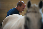 Veteran Ronald Carter participates in a horse therapy program at the Ohio Horse Park.