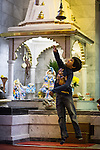 © Joel Goodman . 18 May 2013 . Gita Bhavan Hindu Temple , Withington Road , Whalley Range , Manchester . Aashish Jairath (five) tries to reach the bell to ring it . Commemorative service to celebrate the handover of the Green Kumbh Yatra (green journey pot or environmental pilgrimage) at the Gita Bhavan Hindu Temple in Manchester . The pot has travelled to the Maha Kumbh Mela , Kenya , Nepal and the Western Wall in Jerusalem along the way . At every place of rest an environmental action must be taken to reflect the pot's environmental significance . It's due to travel to Leicester and feature in an outdoor procession in London on 24th May 2013 . Photo credit : Joel Goodman
