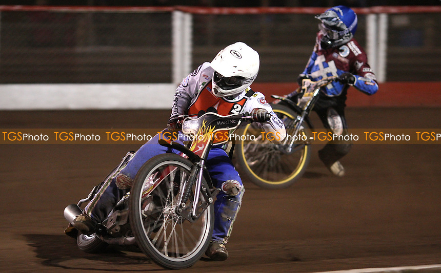 Heat 8: Chris Schramm (white) and Kim Nilsson (blue) - Lakeside Hammers vs Belle Vue Aces, Elite League at the Arena Essex Raceway, Pufleet - 30/03/12 - MANDATORY CREDIT: Rob Newell/TGSPHOTO - Self billing applies where appropriate - 0845 094 6026 - contact@tgsphoto.co.uk - NO UNPAID USE..